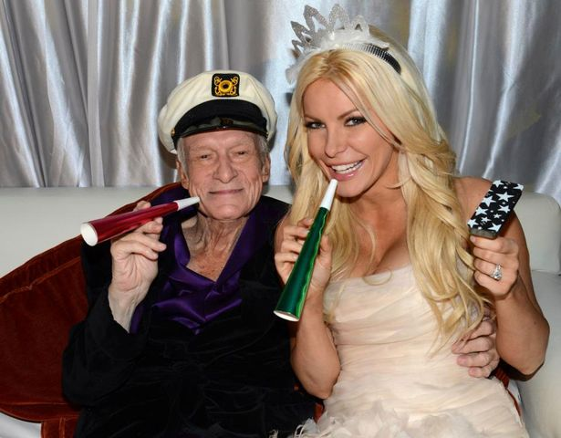 Octogenarian-Playboy-founder-Hugh-Hefner-poses-with-his-bride-Crystal-Harris-as-they-ring-in-the-new